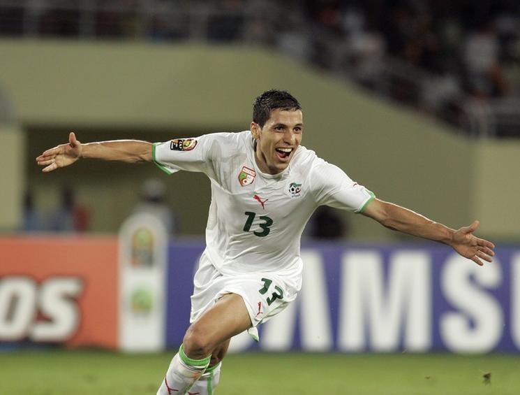 Karim Matmour of Algeria celebrates his goal during their African Nations Cup quarter-final soccer match against Ivory Coast in Cabinda January 24, 2010. REUTERS/Rafael Marchante (ANGOLA -