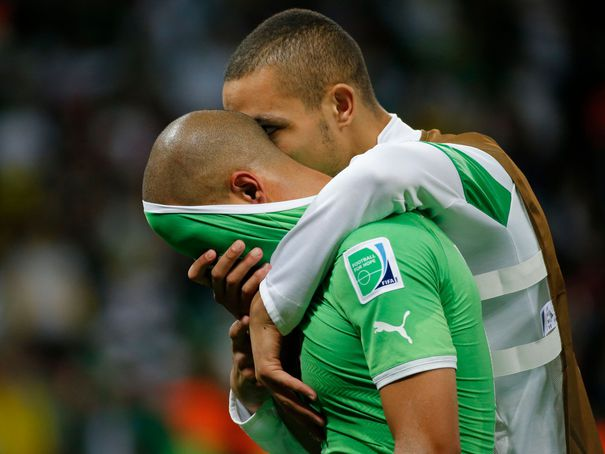 algeria-s-feghouli-is-consoled-by-teammate-mesbah-after-their-loss-to-germany-at-the-end-of-their-2014-world-cup-round-of-16-game-at-the-beira-rio-stadium-in-porto-alegre_4946249