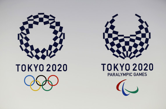The Tokyo Organizing Committee of the Olympic and Paralympic Games displays the new official logos of the 2020 Tokyo Olympics, left, and the 2020 Tokyo Paralympic Games. Organizers unveiled the new official logo of the 2020 Tokyo Olympics on Monday, April 25, opting for blue and white simplicity over more colorful designs. The winning logo, selected from four finalists, is entitled Harmonized Checkered Emblem. It features three varieties of indigo blue rectangular shapes to represent different countries, cultures and ways of thinking. (AP Photo/Shizuo Kambayashi)