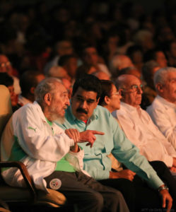 "In this handout picture released by Prensa Miraflores, former Cuban President Fidel Castro (L), sitting next to Venezuelan President Nicolas Maduro, is seen attending the celebration of his 90th birthday at the Karl Marx theatre in Havana on August 13, 2016. / AFP / Prensa Miraflores / XGTY/RESTRICTED TO EDITORIAL USE-MANDATORY CREDIT ""AFP PHOTO/PRENSA MIRAFLORES"" NO MARKETING NO ADVERTISING CAMPAIGNS-DISTRIBUTED AS A SERVICE TO CLIENTS-GETTY OUT (Photo credit should read /AFP/Getty Images)"