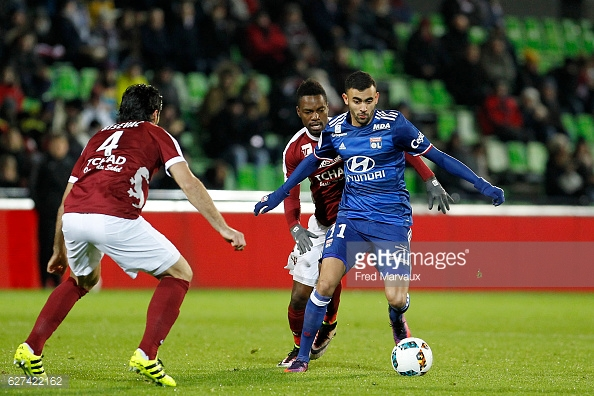 Georges Mandjeck of Metz and Rachid Ghezzal of Lyon during the Ligue 1 match between FC Metz and Olympique Lyonnais at Stade Saint-Symphorien on December 3, 2016 in Metz, France. (Photo by Fred Marvaux/Icon Sport)